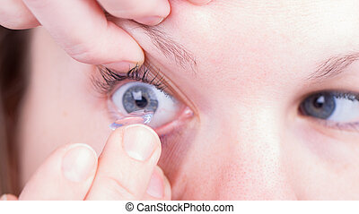 Close up of inserting a contact lens