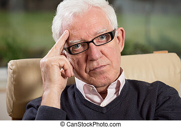Close-up of intelligent elder man