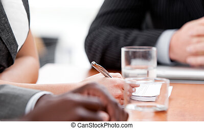Close-up of international business people in a meeting