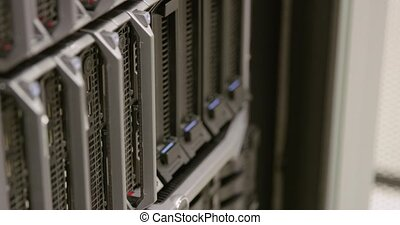 Close-up of IT technician replacing harddrive in server in datacenter