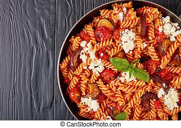 close-up of Italian Pasta fusilli alla Norma