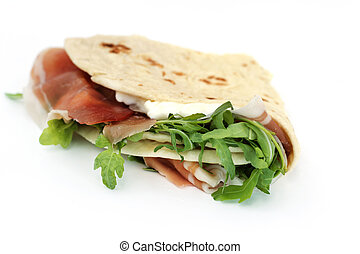 close up of italian typical sandwich with ham on white background