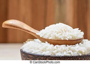 close-up of jasmine rice on wooden table