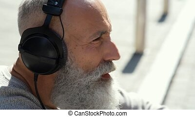 Close up of joyful bearded man singing - Positive attitude...