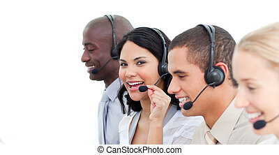 Close-up of joyful business people working in a call center