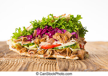 close up of kebab sandwich on white.
