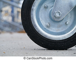 Close up of kids wheel on the road.