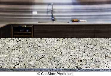 Close up of kitchen counter top with blurred kitchen background