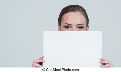 Close-up of lady closing white paper