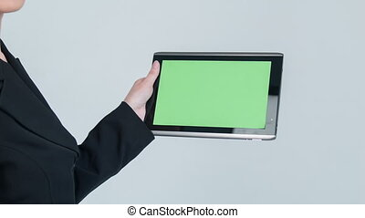 Close-up of lady working with tablet