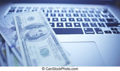 Close-up of laptop keyboard - Online investments. Sliding...