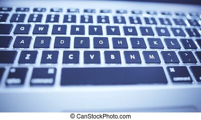 Close-up of laptop keyboard - Sliding video of laptop...