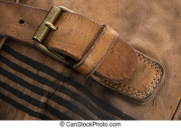 Close Up of Leather Strap Fastened to a Metal Buckle