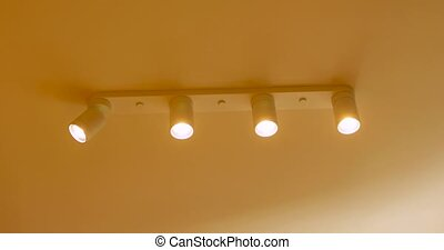 Close-up of LED light in home ceiling turning on