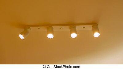 Close-up of LED light ceiling turning on - Close-up of LED...