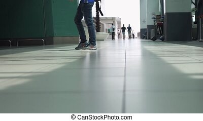 Close up of legs of unrecognizable people with baggages walking in terminal airport. slow motion. 3840x2160