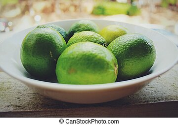Close-Up Of Lemons In Plate