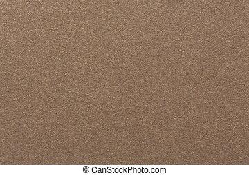 Close up of light beige handmade paper.