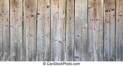 Close up of line light brown wooden fence.