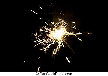 Close up of lit up sparkler