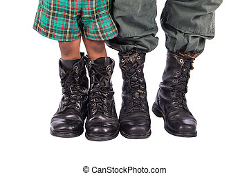 Close-up of little boy and dad wearing shoes