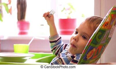 Close up of little cute boy eating spaghetti. 3840x2160