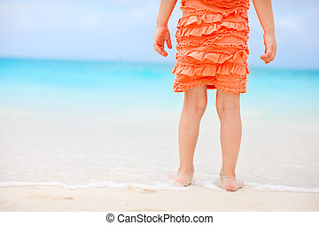 Close up of little girl at beach