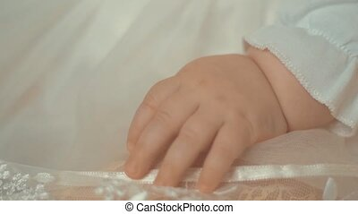 Close up of little newborn child's hand. Shot with small ...