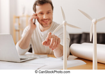 Close up of little windmills that standing on the table