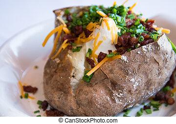 loaded baked potato - close up of loaded baked potato on a ...