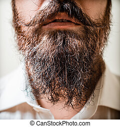 Close up of long beard and mustache man with white shirt