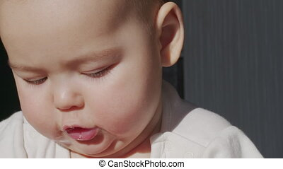 Close up of lovely little baby girl smile. Portrait of infant smile