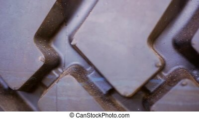 Close up of macro rubber tire tread. Video shift motion -...