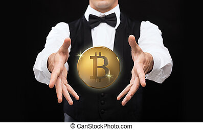 close up of magician with bitcoin over black