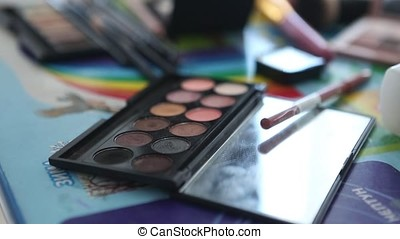 Close-up of make-up brushes on eyeshadow palette. Make up...