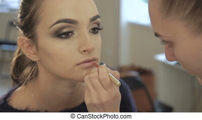 Close up of make up for beautiful woman, applying lipstick pencil