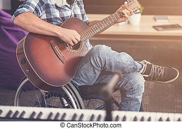 Close up of male body sitting on wheelchair