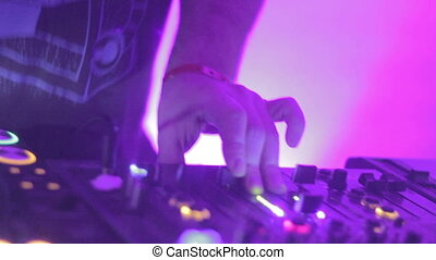 """""""Close-up of male deejay hands tweaking controls on sound deck"""""""