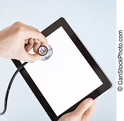 doctor with stethoscope and tablet pc