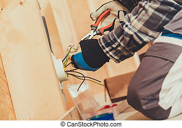 Close Up Of Male Elelctrician Preparing Wire Ends For Plug ...