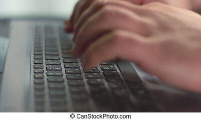 """Close up of male fingers pressing buttons on laptop keyboard"""