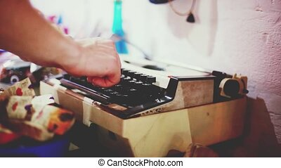 Close up of male fingers typing on the keyboard of an...