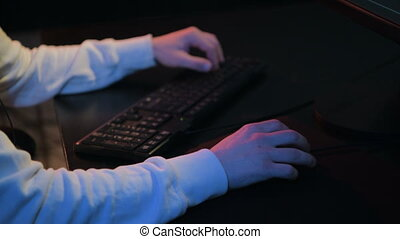 Close-up of male gamer's hands playing computer game on...