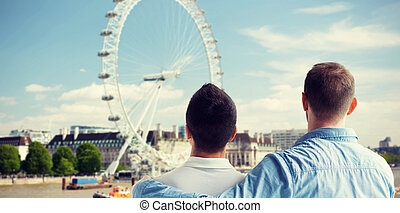 close up of male gay couple looking at london view - people,...