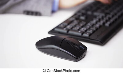 close up of male hand with keyboard and mouse