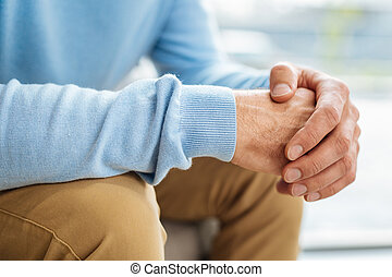 Close up of male hands being held together