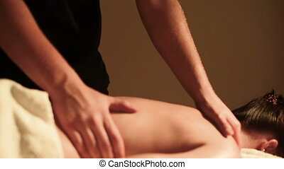 Close-up of male hands of a massage therapist doing massage...