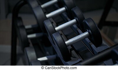 Close-up of male hands taking the dumbbell, slow motion
