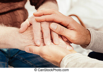 Close up of male hands that expressing support