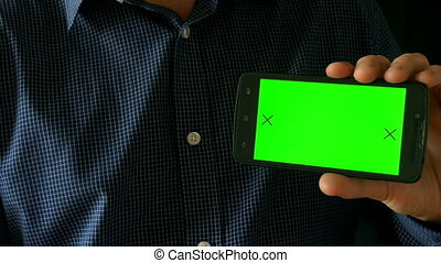Close-up of male hands touching of smartphone. Green screen Chroma Key. Close up. Tracking motion. Vertical. pants. - Swipe left right animation black 6